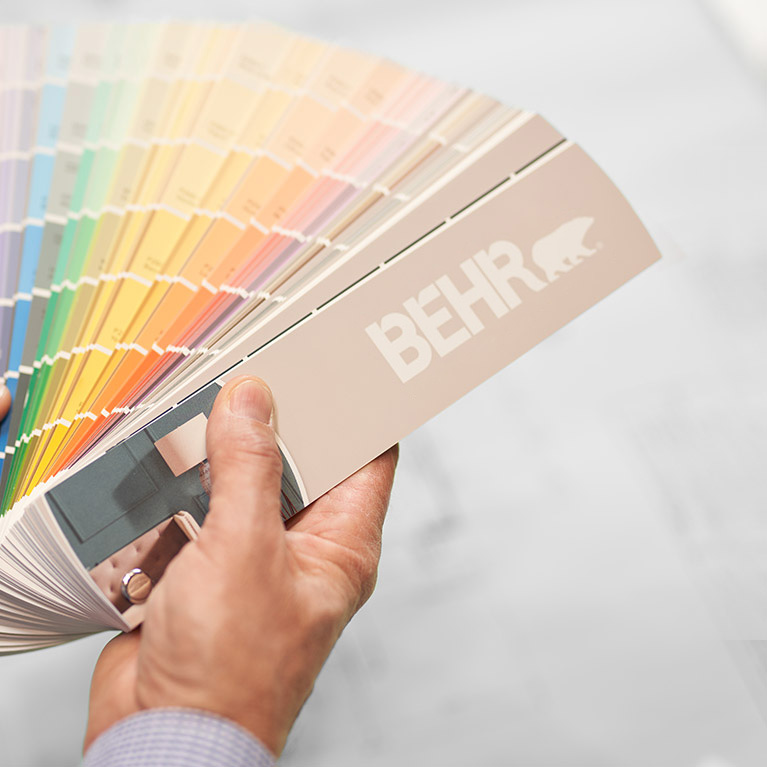 A small image of a BEHR Colour Fan Deck held by a hand.