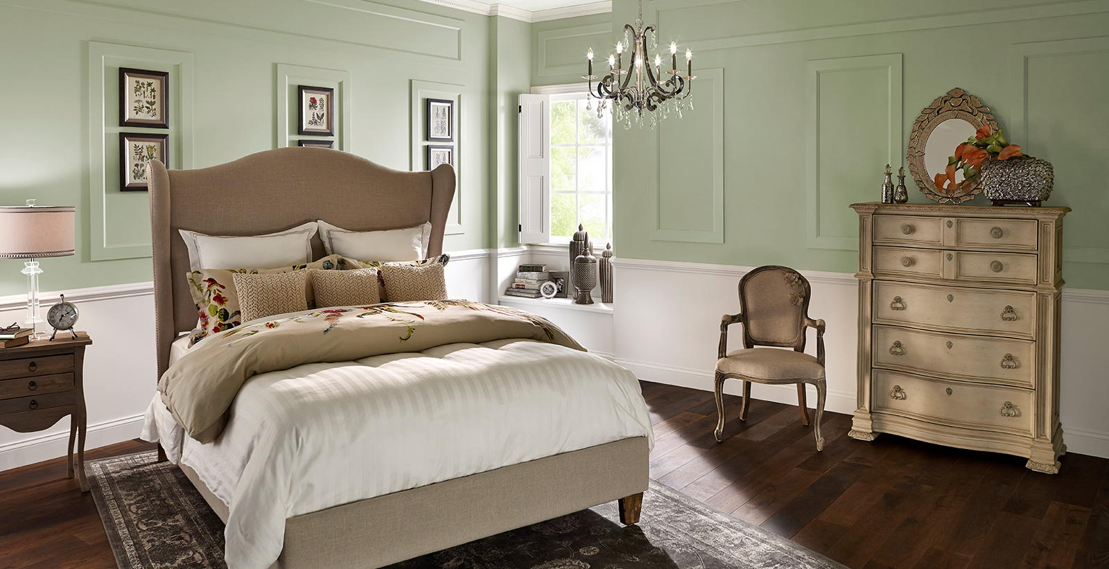 Traditional styled bedroom with pale green on top half of walls, white on bottom half, and tan upholstered bed frame and headboard