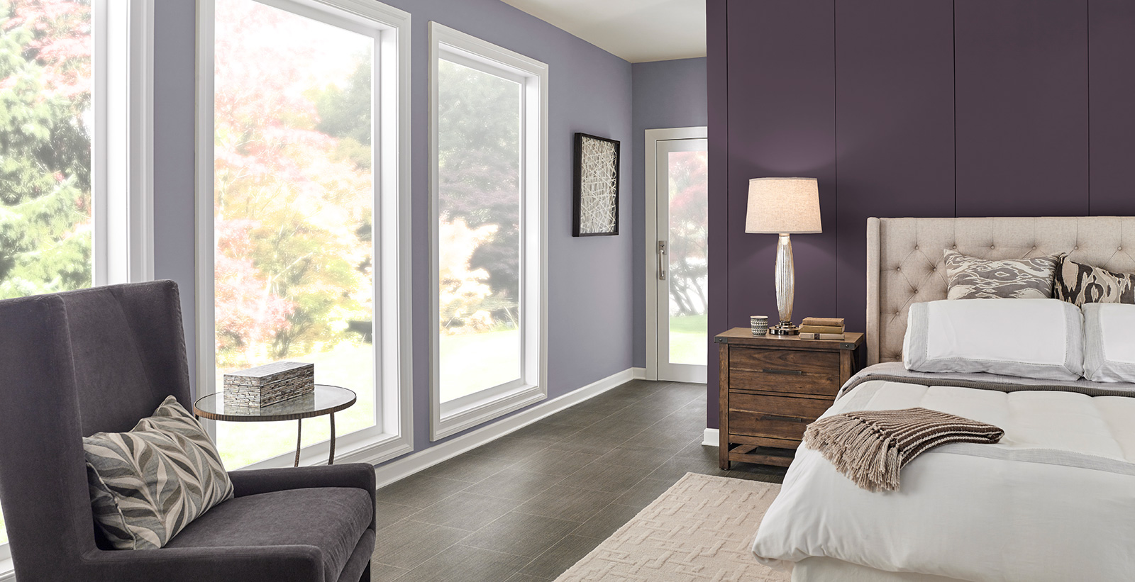 Formal styled bedroom with light purple on main walls, dark purple on accent wall, white on trim and ceiling, and tufted headboard
