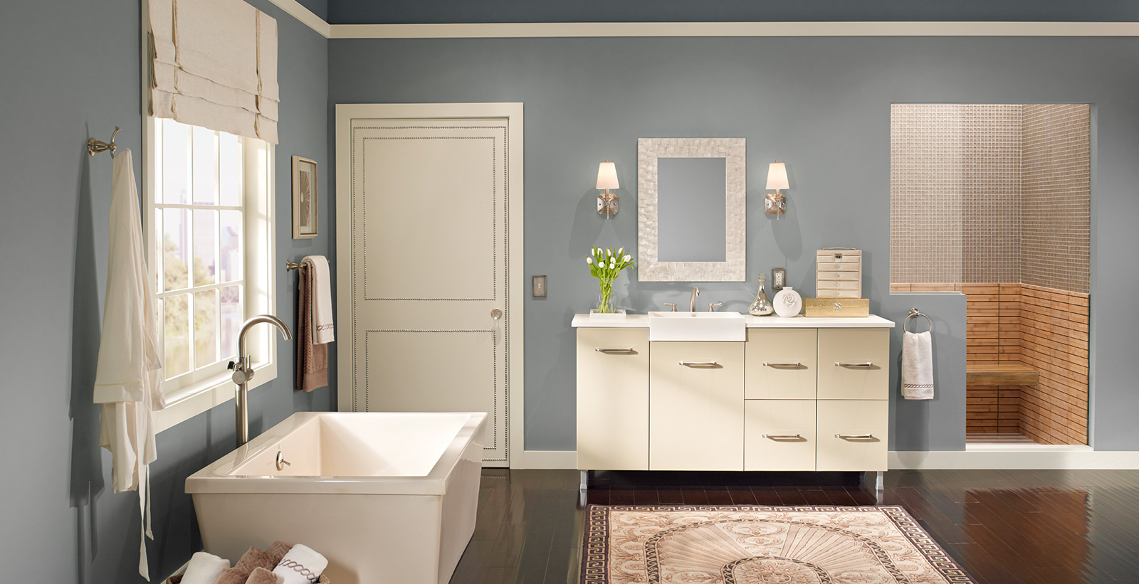 Relax styled bathroom with blue-gray walls and white trim.