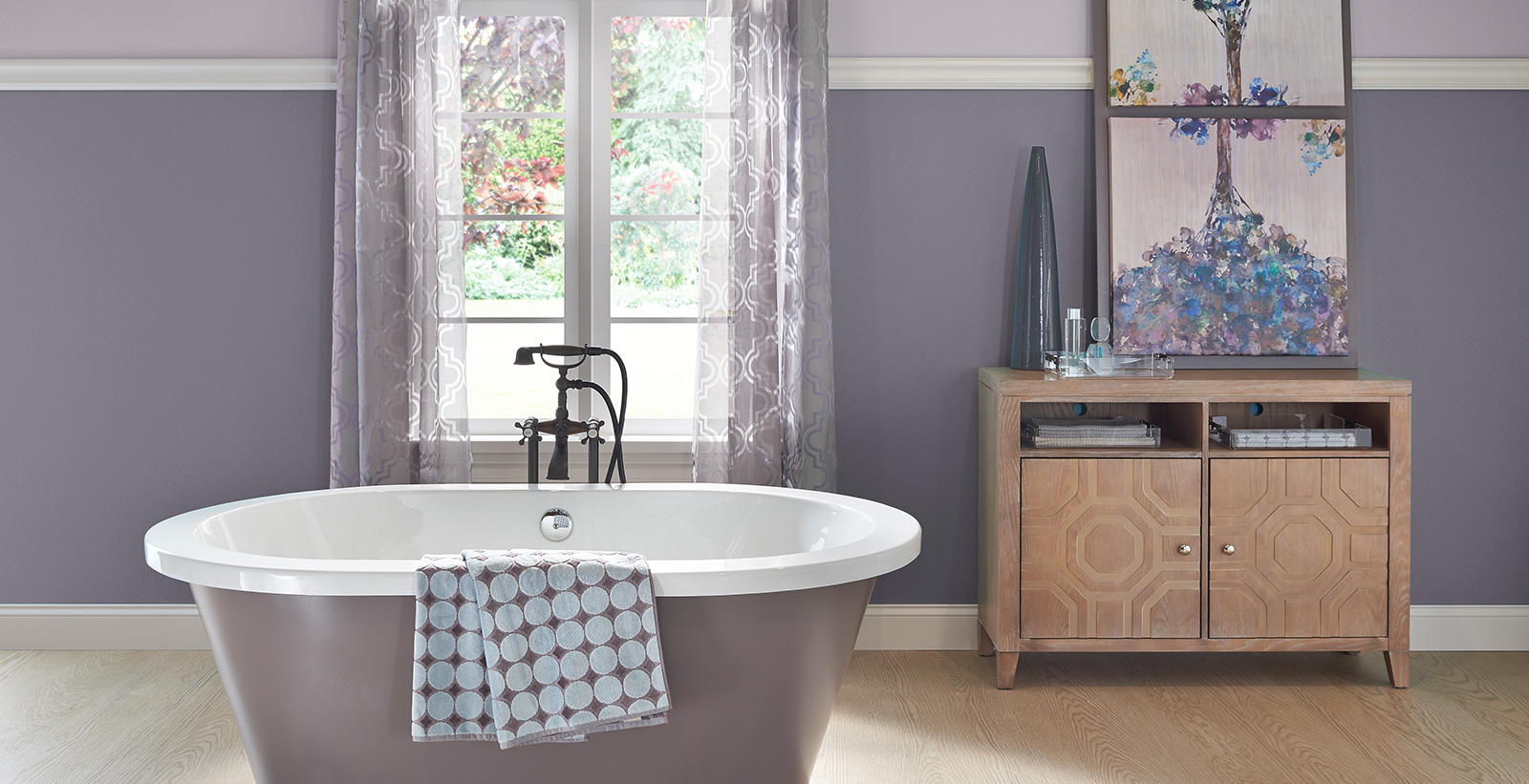 Relaxed and calming styled bathroom with purple walls and white trim.