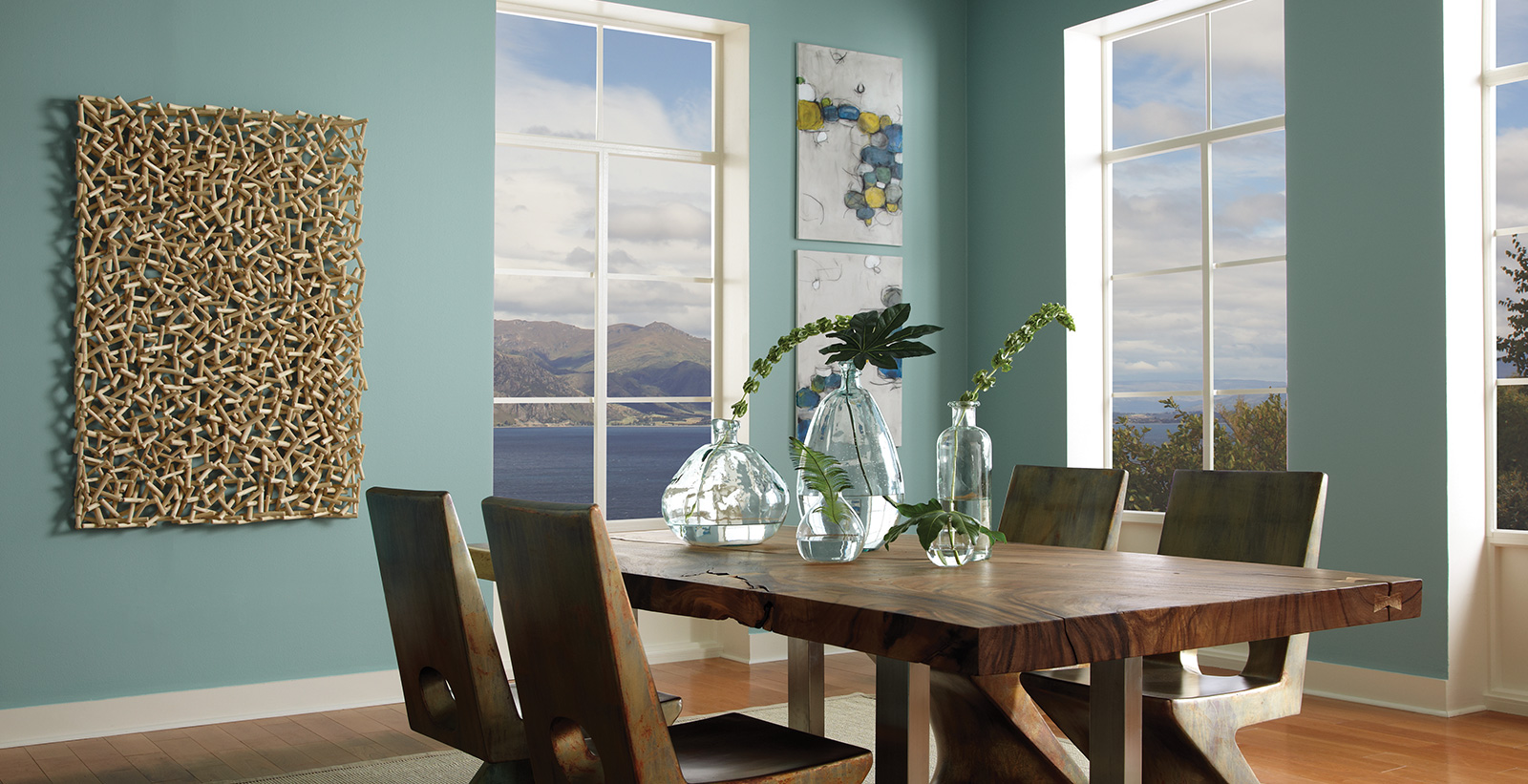 Casual dining room with Opal Silk green paint on walls, white paint on trim, wood-grained trestle dining table.