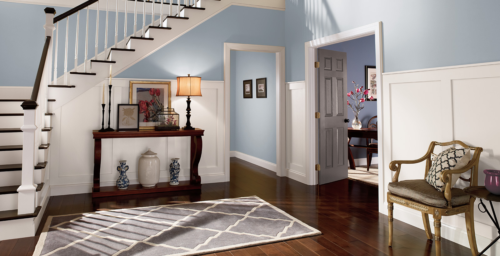 Relaxed Hallway with gray walls, white trim, and cool tone style.