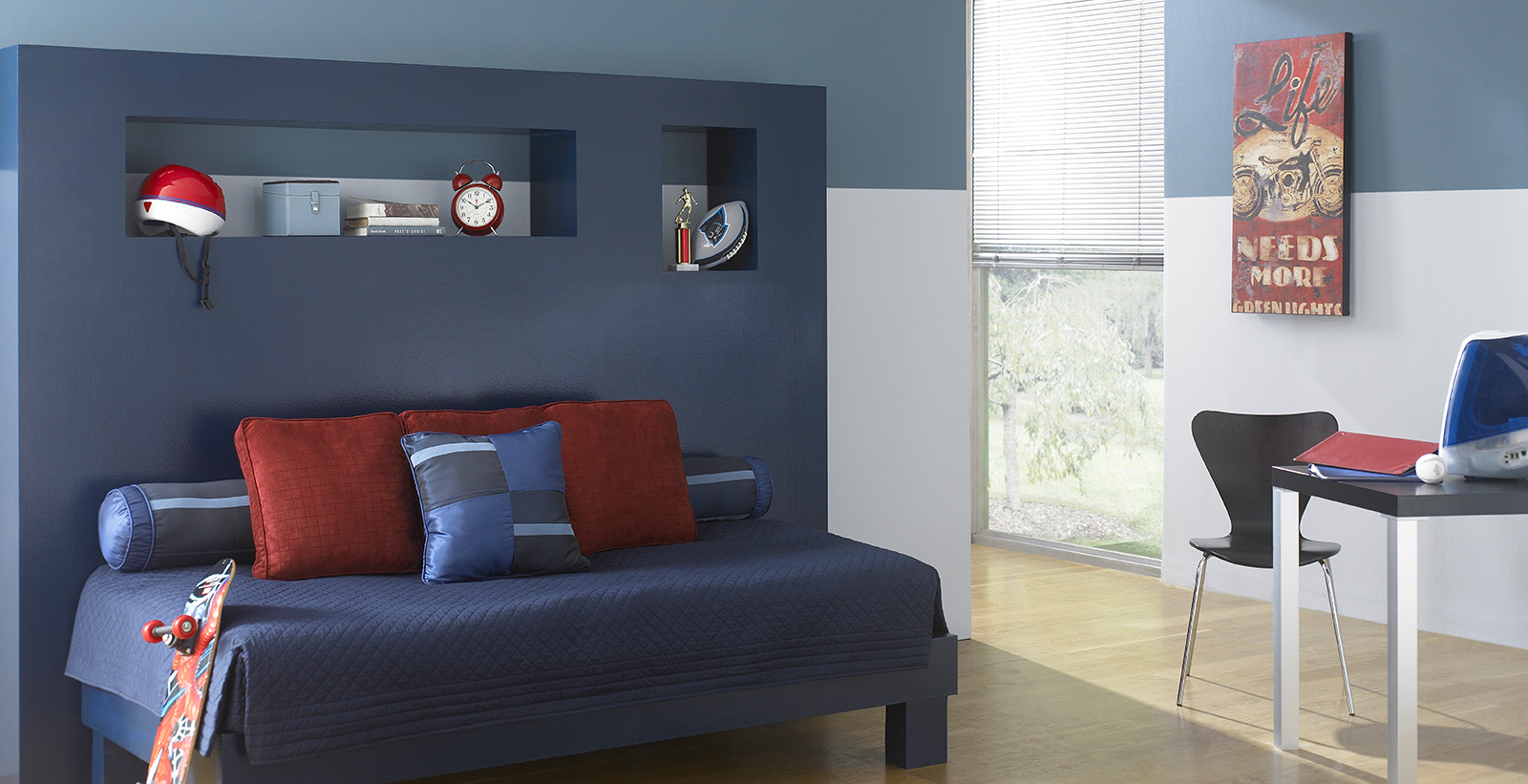 Relaxing styled youth room with light gray and blue walls, dark blue accent, and modern themed decoration.
