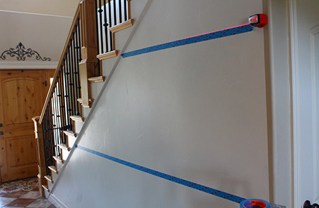 Use painter's tape to mark the location of the horizontal boards