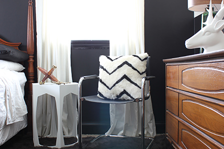 The solid white curtains and black-and-white pillow pick up the new colour scheme
