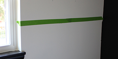 Tape line across the wall to divide colours
