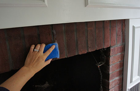 Cleaning brick of the fireplace prior to painting