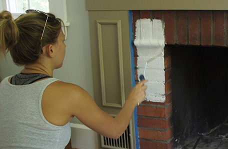 Paint the brick with a thick-nap roller