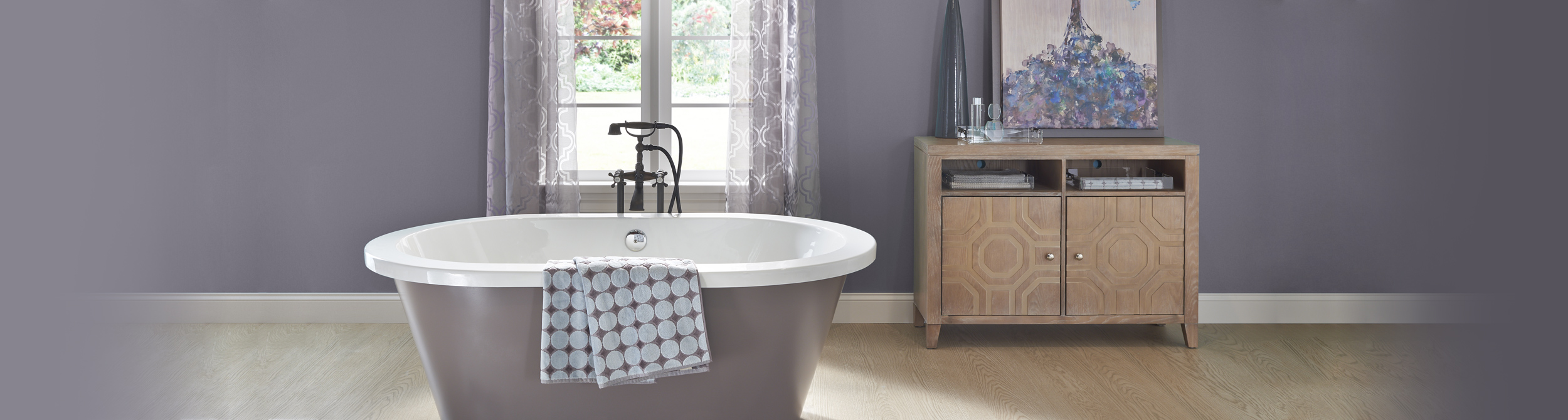 Inspirational bathroom image with dark purple and light purple split walls and white trim.