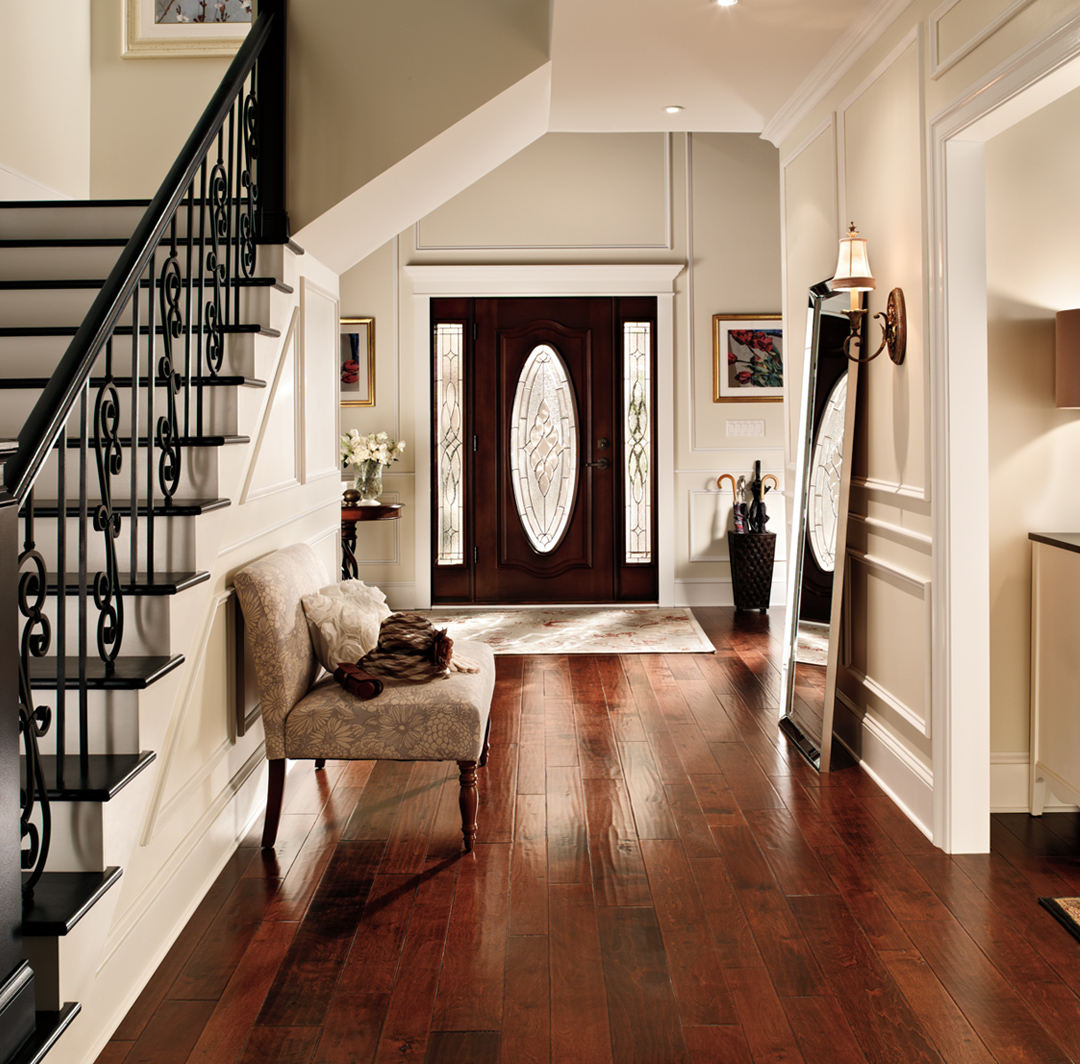 Hallway with stairs inspiration with white walls, white trim, wooden door, small image.