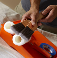 2 brushes, 2 roller covers, paint tray and painter's tape.