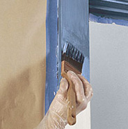 Painting garage door trim.