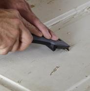 Scrape off peeling paint.