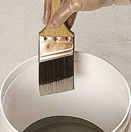Dip brush into paint.