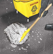 Mop up excess water.