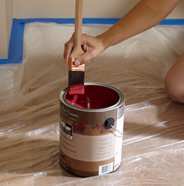 Wipe excess paint onto can rim.