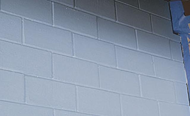 Light blue colored brick wall