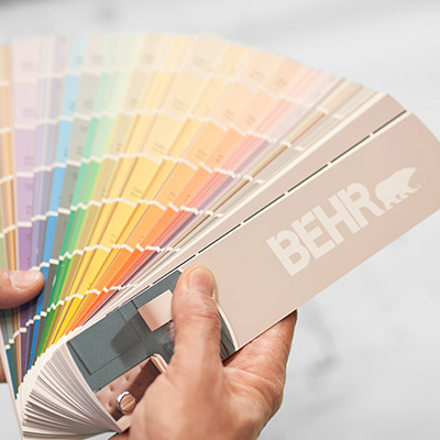 A BEHR Fan Deck held by a hand.