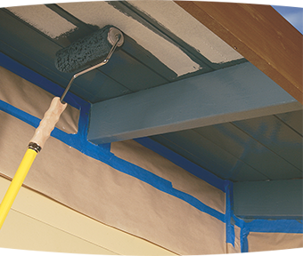 Close-up of roller painting under eaves