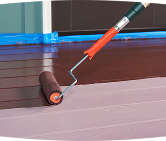 Applying paint to porch patio
