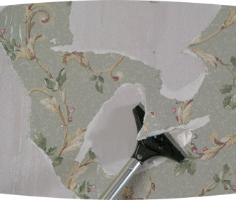 Scrapping tool removing wallpaper from a wall