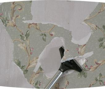 Outil enlevant le papier peint d'un mur