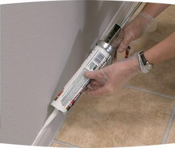 Person repairing seam above trim