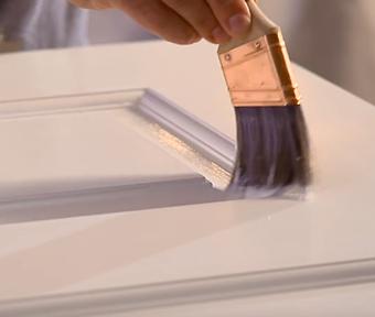 Person painting door trim