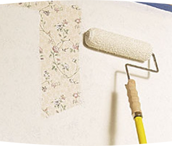 Paint roller painting over wallpaper