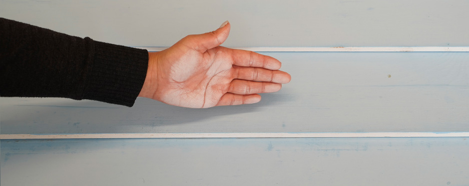 Hand checking chalkiness of painted wall, pass 8