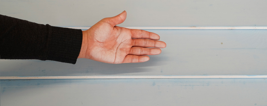Hand checking chalkiness of painted wall, pass 9