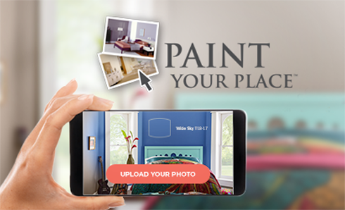 Mobile device taking photo of room with Paint Your Place logo in background