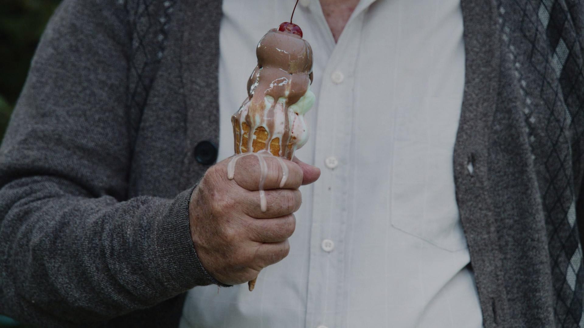 Man holding a melting ice cream cone