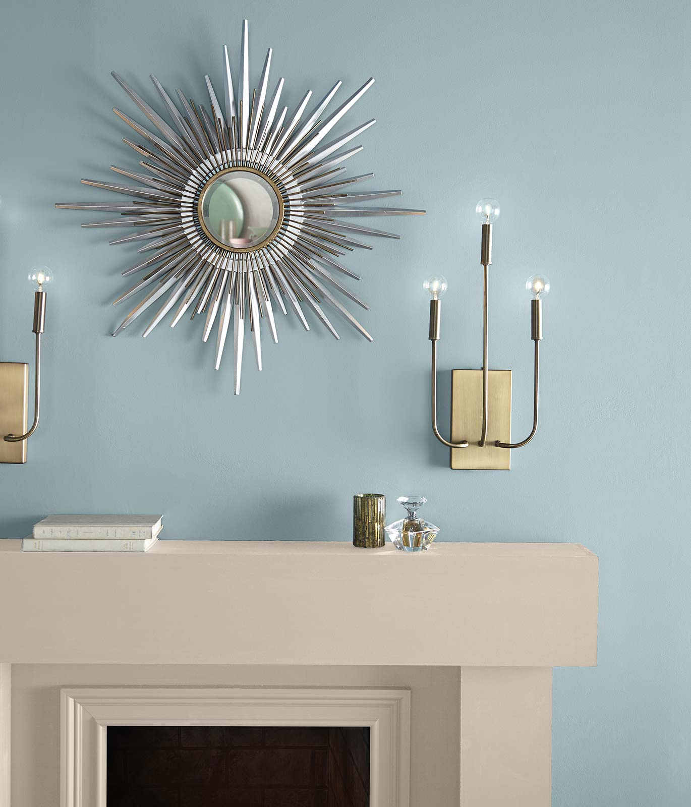 A tight crop of a cream colored fireplace against a denim blue painted wall inspiring a calm feeling